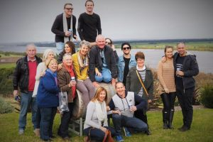 A Berry Wine Tasting Day Tour at Two Figs Winery taking a group photo with the Shoalhaven River in the background