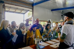 A group enjoying a wine tasting at Two FIgs Winery on a Wollongong Wine Tour