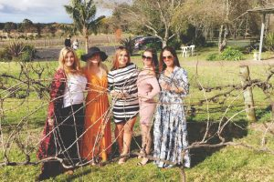 In the vines at Cambewarra Estate enoying one of the best things to do in Berry - a wine tasting tour!