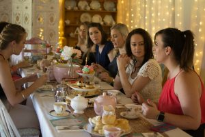 A group of ladies on A Wollongong Hens Party enjoying a High Tea in the Vines Wine Tour