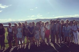 A photo of a group of girls on a hens day at Two Figs winery with the shoalhaven river in the background