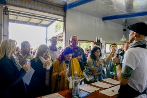 A group enjoying a wine tasting on a Sydney Wine Tasting Tour at Two Figs Winery