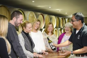 A group enjoying a wine tasting at Silos Estate in Berry on a Wollongong Wine Tour