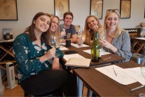 Group enjoying wine tasting on best tour from sydney